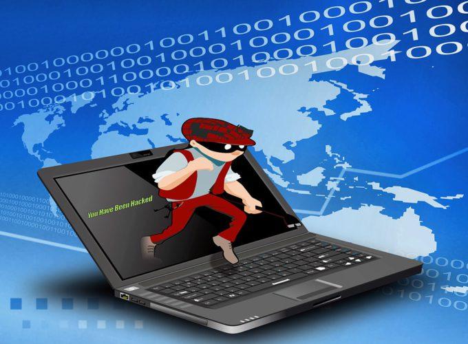 Das Bild zeigt einen Laptop, aus dem ein Gauner aussteigt. Es symbolisiert den Datenklau durch Emotet. Foto: Pixabay