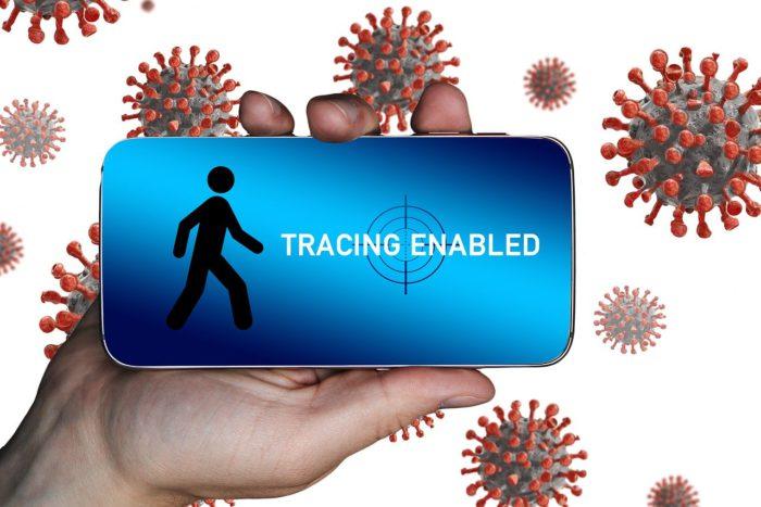 Was ist Tracing? Bild zeigt Hand in der Hand, im Hintergrund schwirren Viren umher, Tracing wird laut Display erlaubt. Bild: Pixabay