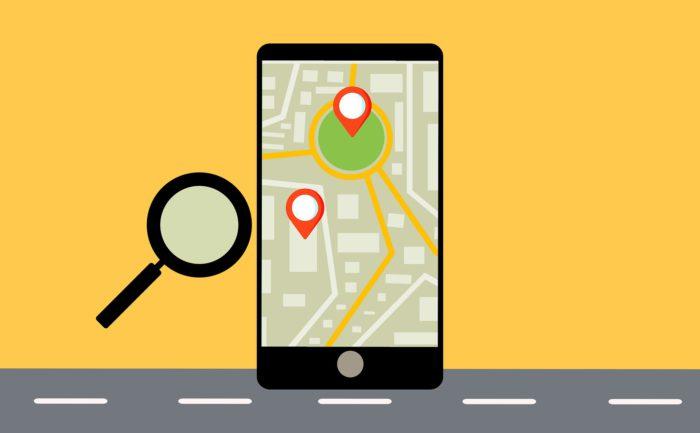 Apple Wo ist. Gezeichnetes Handy mit einem Ortungsprozess und einer Lupe. Bild: Pixabay