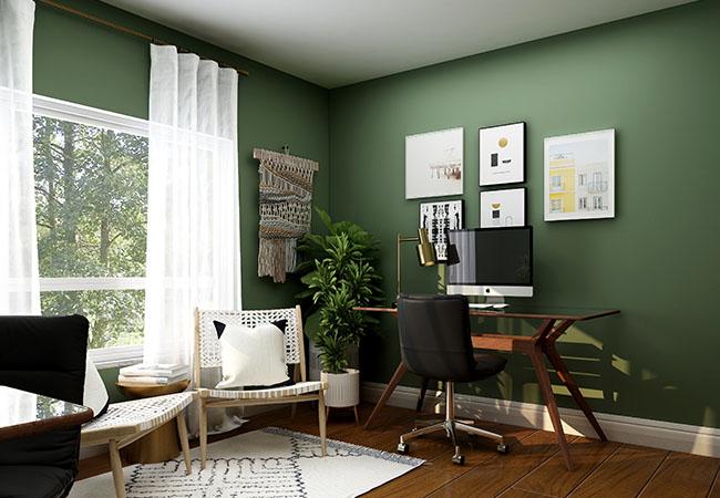 Bildschirmarbeitsplatz vor grüner Wand im Wohnzimmer. Dank New Work selbstverständlich. Bild: Unsplash/Collov Home Design